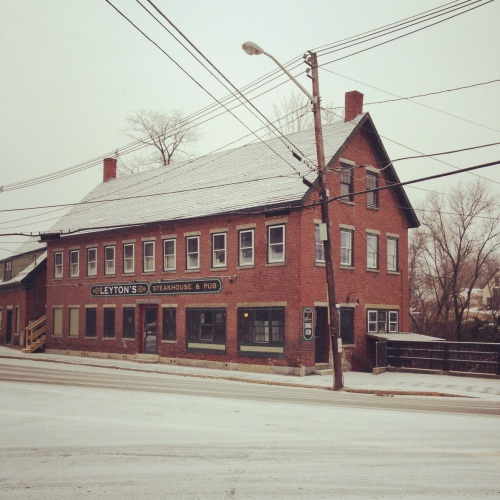 snowy brick building